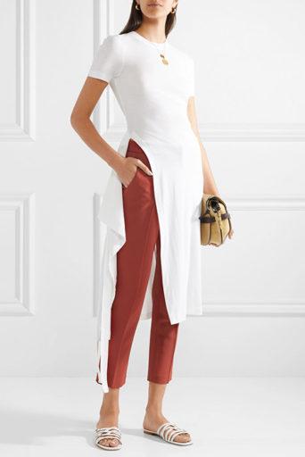 eb14e9f0 Для всех фасонов характерна одна черта – штанины, сужающиеся книзу. Сами  брюки могут быть разными – достаточно широкими или прямыми, короткими или  длинными.